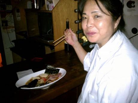 Satsko Watanabe tasting Pork Ramen at Sake Bar Satsko