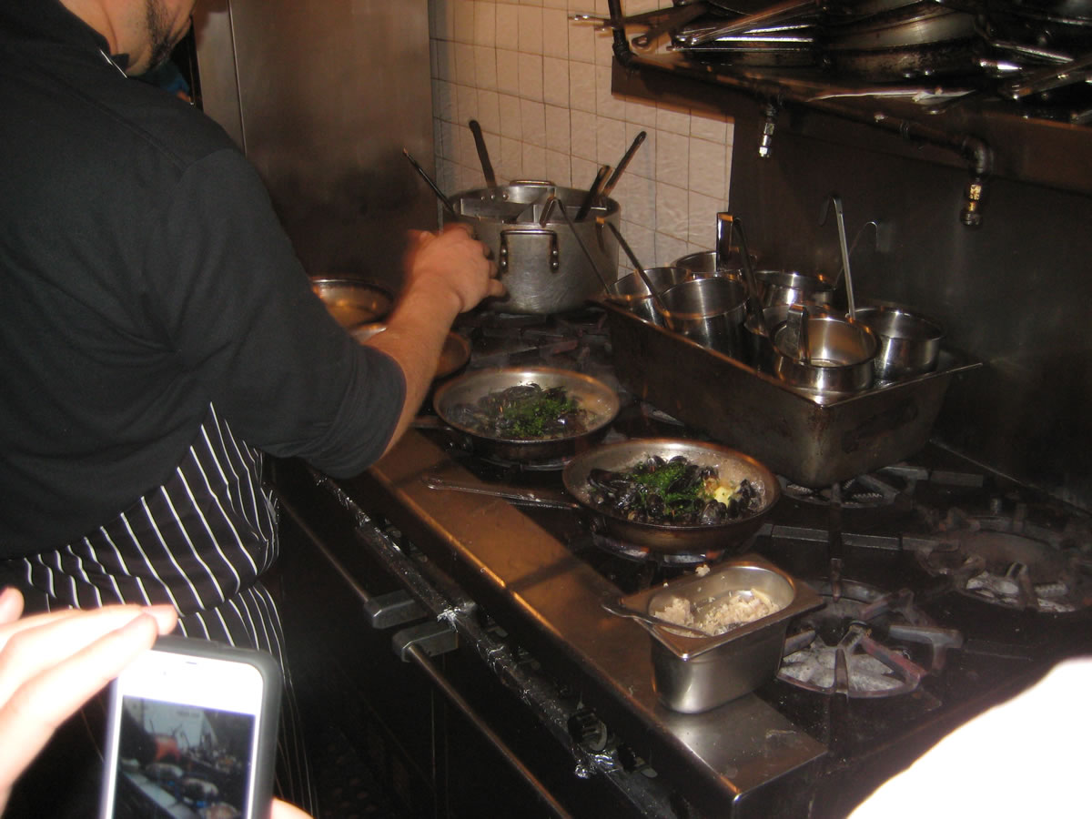 Adding Parsley to Steamed Mussels at Affaire